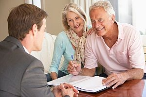 a financial consultant speaking with a retired couple to inform them about their 401k as well as the 401k withdrawal penalty and how to avoid it