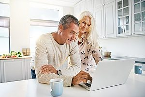 an elderly couple who are filing their 401(k) forms with the IRS to make sure they do not have a 401(k) withdrawal penalty