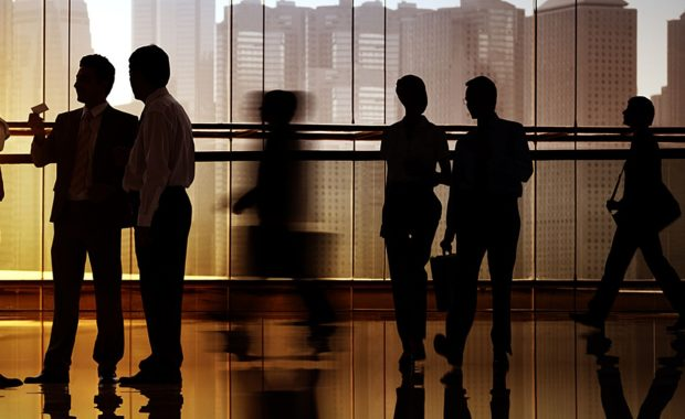 silhouettes of a group of business men and women who all plan to open a 401(k) retirement account in the near future