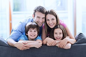 a young family of four that have recently spoke to financial consultants about a potential life insurance policy just in case something were to happen to one of the parents
